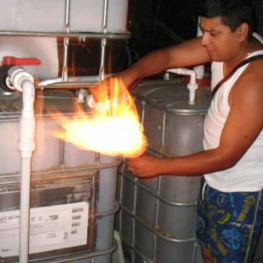 """Flame On"" -- Biogas in the 'Hood demonstrated by Alvaro Silva, director of Solar South Central and Los Angeles colleague of Solar CITIES, bringing renewable energy systems to the Latino community."