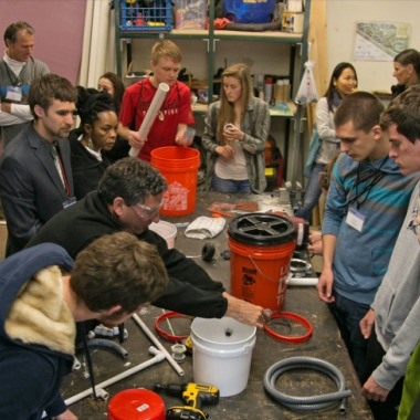 Culhane teaches participants to build a mini biodigester